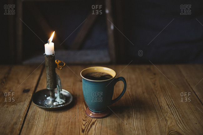 Black coffee and candle on table