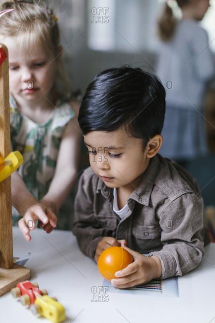 Boy playing in preschool