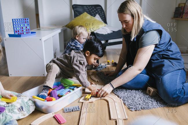 Teacher with children in playschool