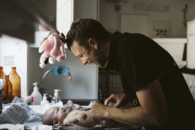 Father with baby at home