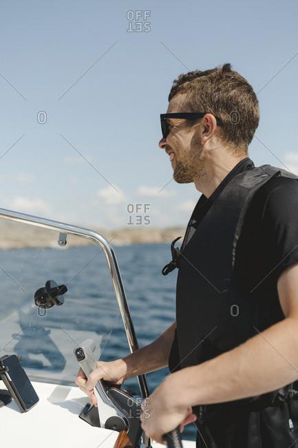 Man steering boat
