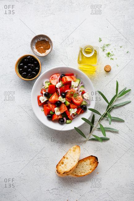 Greek salad on light background