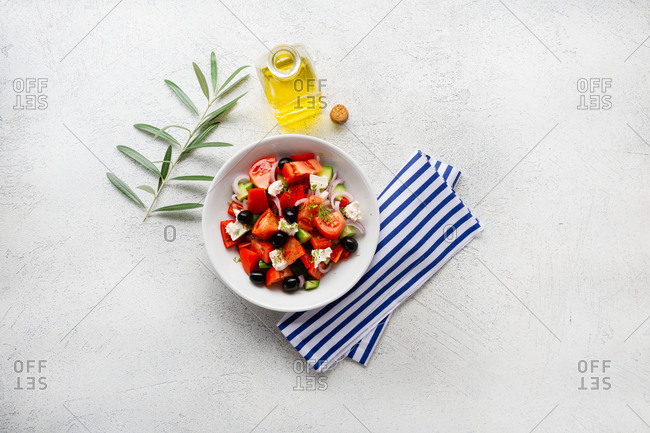 Fresh Greek salad on light background from above