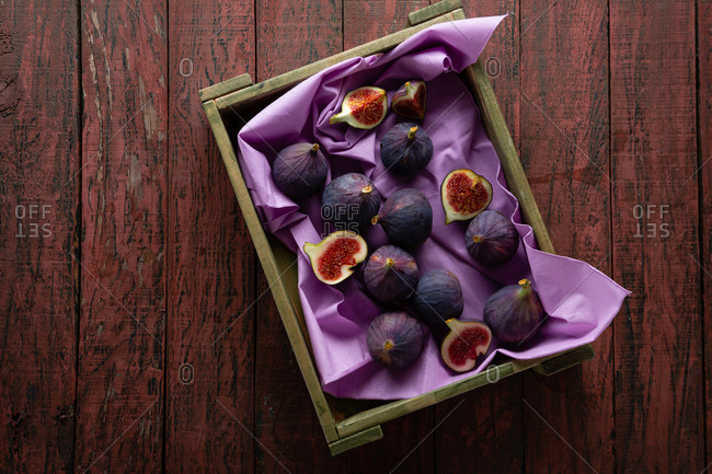 Harvested figs in a wooden crate
