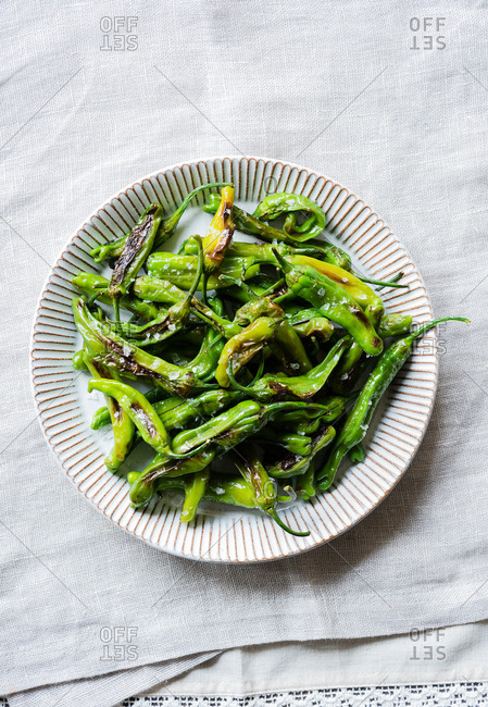 Fried shishito peppers (padron peppers) on a plate from above