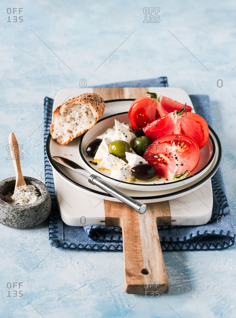 Breakfast with heirloom tomatoes, feta cheese, olives, served with multigrain bread