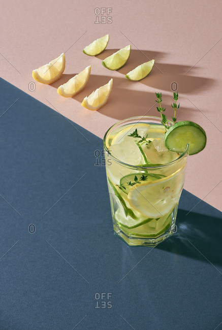 Health care, fitness, healthy nutrition diet concept. Fresh cool lemon cucumber mint infused water