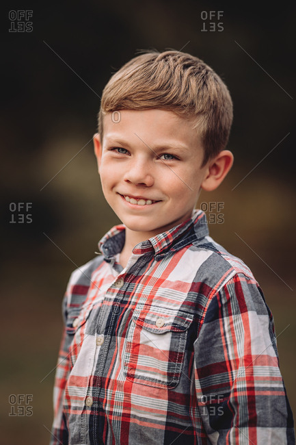 Portrait of a smiling boy wearing a plaid shirt