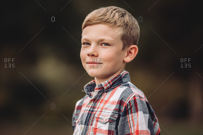 Portrait of a boy wearing a plaid shirt