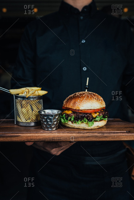 Juicy beef burger with cheddar cheese and French fries