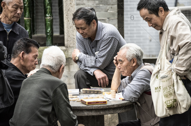 Foshan, China - February 22, 2017: Chinese men playing draughts in Zumiao ancestral temple, Foshan