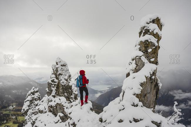 Hiker Trekking on Snowed Mountain