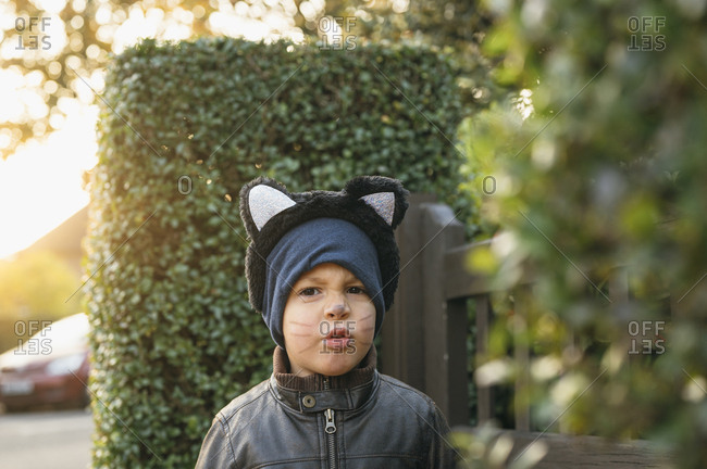 Young boy wearing cat's ear Outdoors At House for halloween