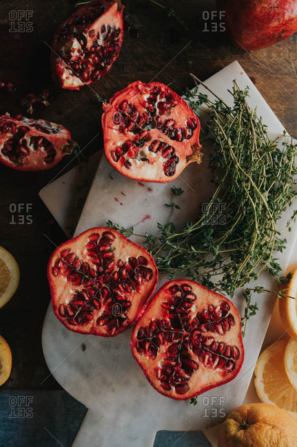 Pomegranates and oranges on counter