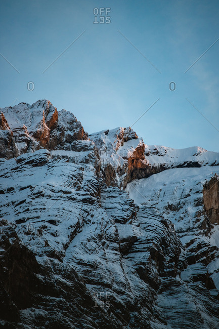 Sunset glow on a snowy mountain ridge