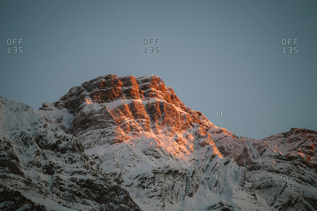 Sunset glow on a snowy mountain peak