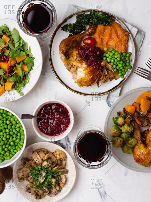 Thanksgiving dinner with roasted chicken, red wine and sides