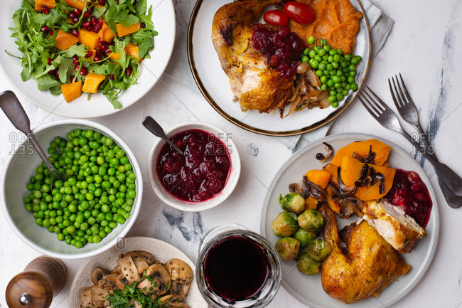Thanksgiving dinner with roasted chicken and vegetable sides