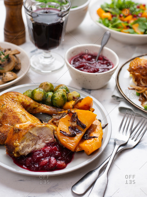 Roasted chicken and sides on Thanksgiving table