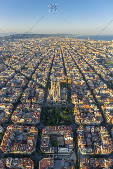 Spain - August 2, 2019: Spain, Catalunya, Barcelona, Aerial view of Eixample district and Sagrada Familia Cathedral