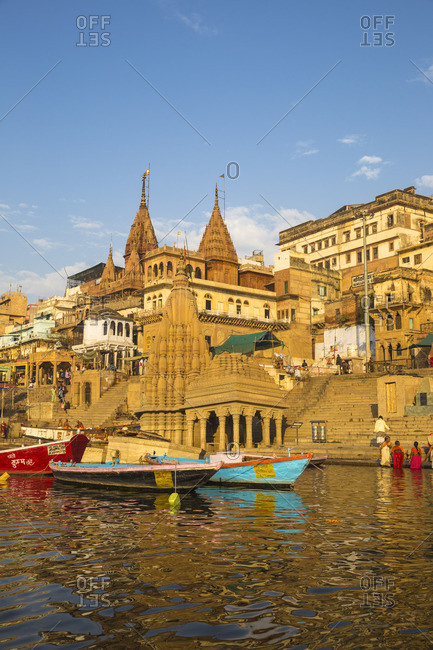 India - February 19, 2019: India, Uttar Pradesh, Varanasi, View towards the submerged Shiva temple at Scindia Ghat
