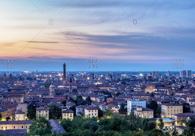 Cityscape with San Domenico Basilica and Asinelli Tower at dusk, elevated view, Bologna, Emilia-Romagna, Italy