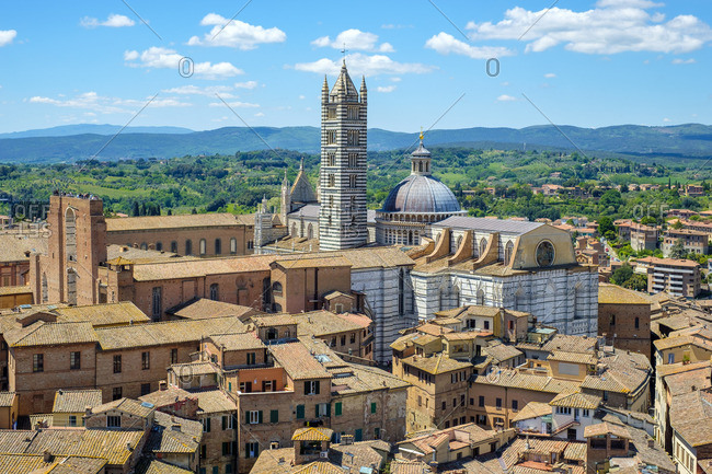 High angle view of Duomo di Siena (Siena Cathedral) and buildings in old town. UNESCO World Heritage Site, Siena, Tuscany, Italy, Europe.