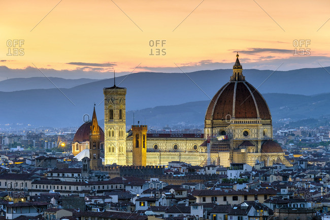 Italy - May 16, 2019: Florence Cathedral (Duomo di Firenze) and buildings in the old town at dusk, Florence (Firenze), Tuscany, Italy, Europe.