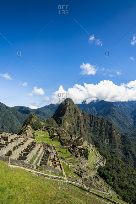 Elevated view of historic Incan Machu Picchu on mountain in Andes, Cuzco Region, Peru