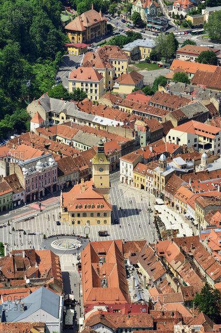 Romania - June 5, 2019: Piata Sfatului (Council Square) with the former Council House, built in 1420, and the old town. Brasov, Transylvania. Romania