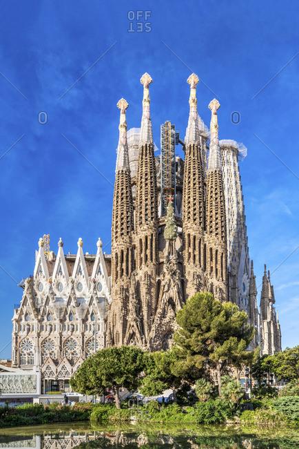 Spain - May 11, 2019: Nativity facade, Sagrada Familia basilica church, Barcelona, Catalonia, Spain