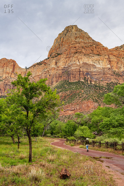 Woman walking the Pa'rus Trail Zion National Park, Utah, USA