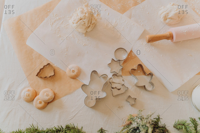 Christmas cookies on the table with flour, dough and cookie stencils