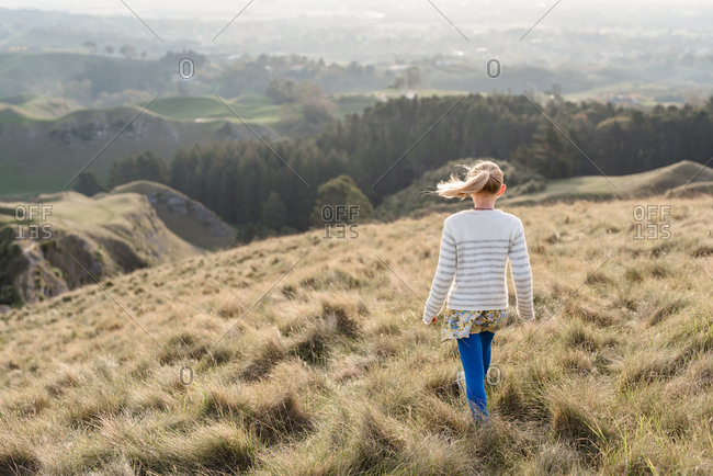 Back view of a girl looking out at Te Mata Peak, Hawke's Bay, New Zealand