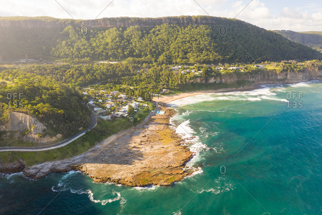 Aerial view of road towards Coalcliff coastal city, New South Wales, Australia.