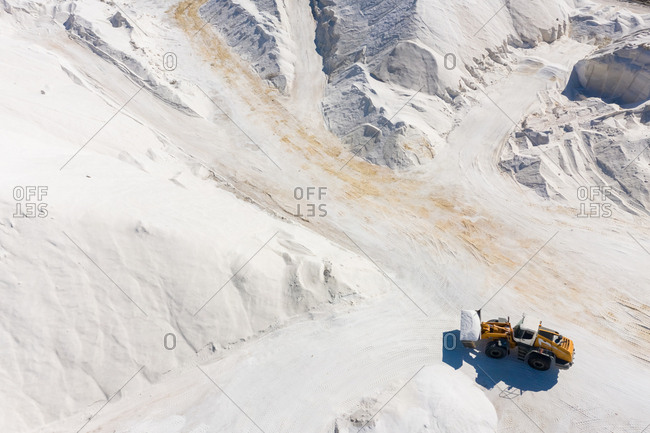 Aerial view of machines working at salt production facility, Australia.