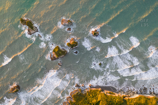 Aerial view of coastal cliff formation at Nine Mile, West Coast during the sunset, New Zealand.