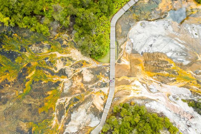 Aerial view of wooden deck crossing Orakei Korako Geothermal Park, New Zealand.