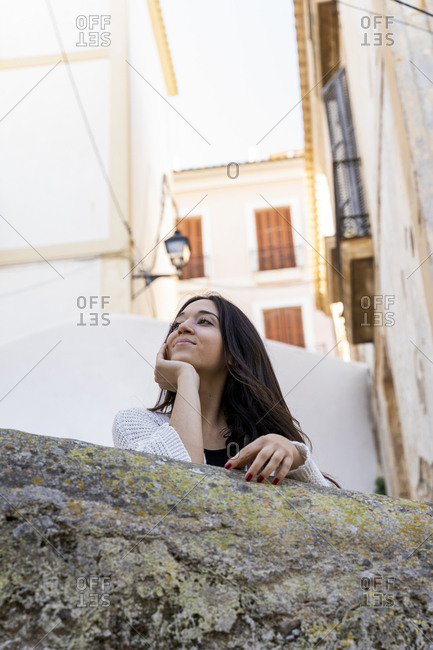 Low angle view of young smiling woman looking sideways