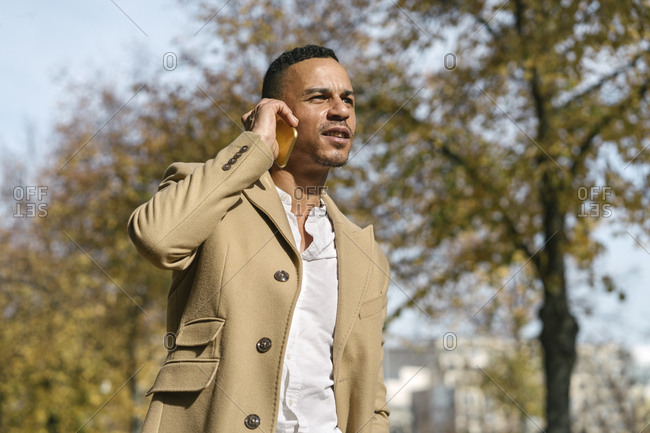 Portrait of businessman on the phone in autumn