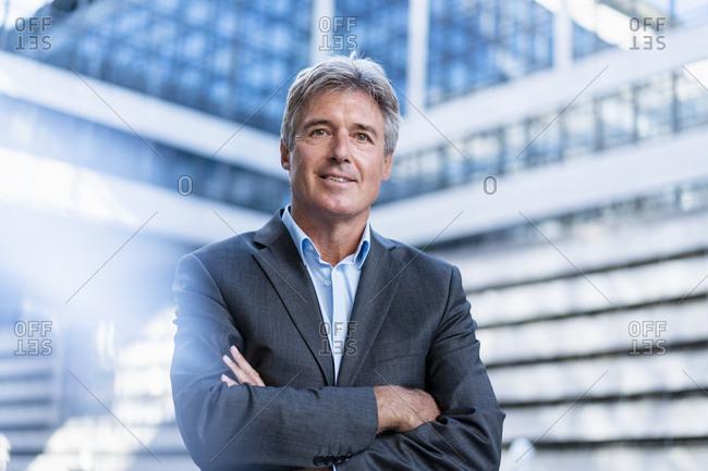 Portrait of confident mature businessman in the city