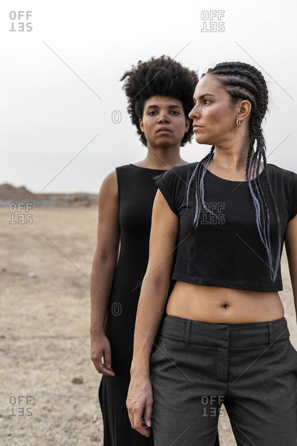 Portrait of two women in bleak landscape