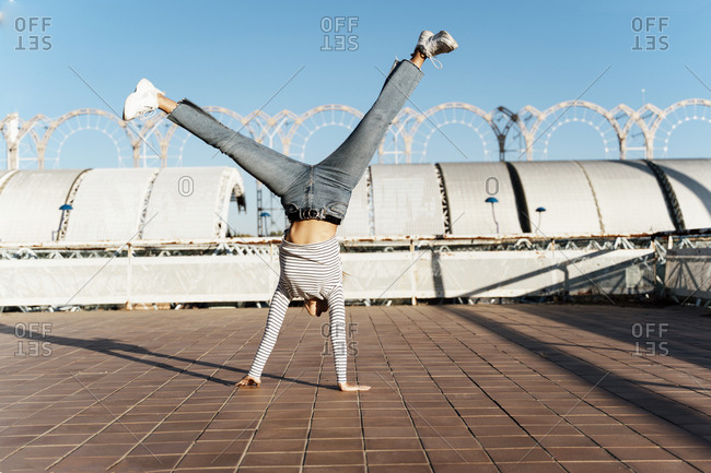 Young blond woman doing a cartwheel