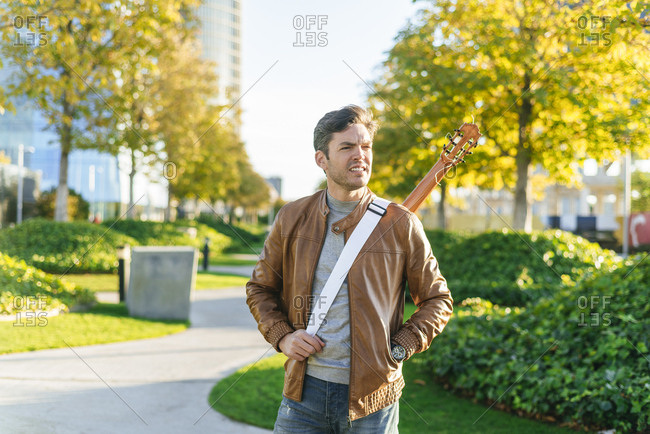 Man in an urban park with guitar- Madrid- Spain