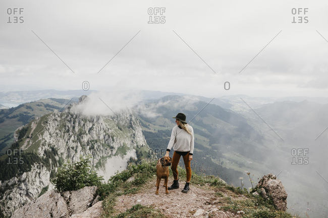 Woman with dog on viewpoint- Grosser Mythen- Switzerland