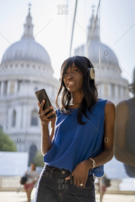 Female Afro-American listening to music in London- England- Great Britain