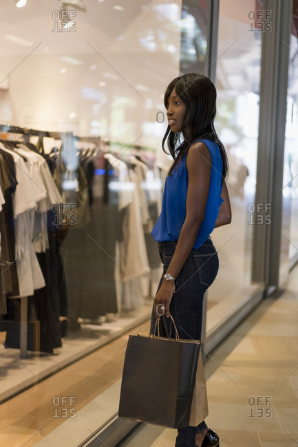 Female Afro-American with shopping bags in a mall