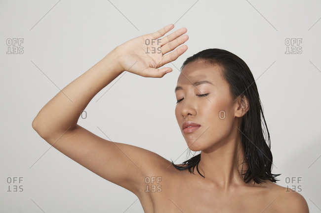 Portrait of young female Chinese woman with closed eyes