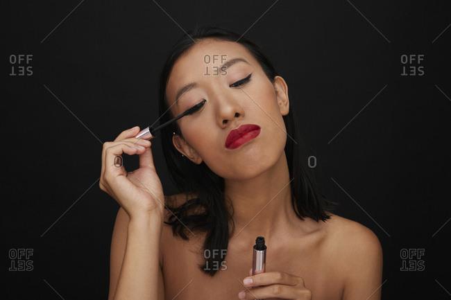 Portrait of young female Chinese woman- eyelashes- mascara
