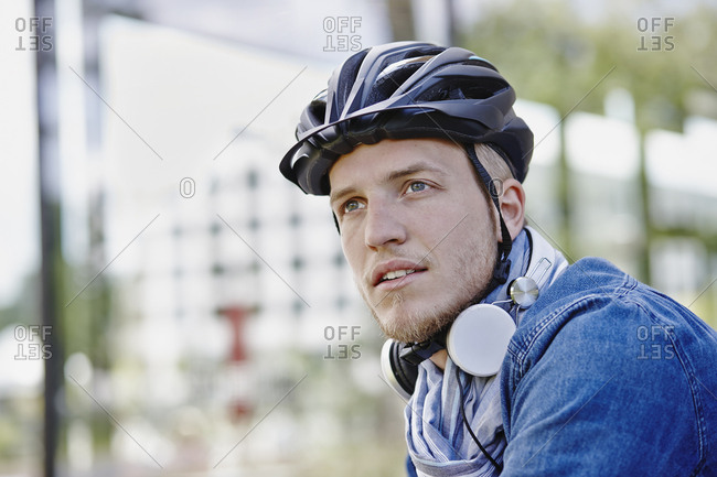 Portrait of student with cycling helmet  and headphones